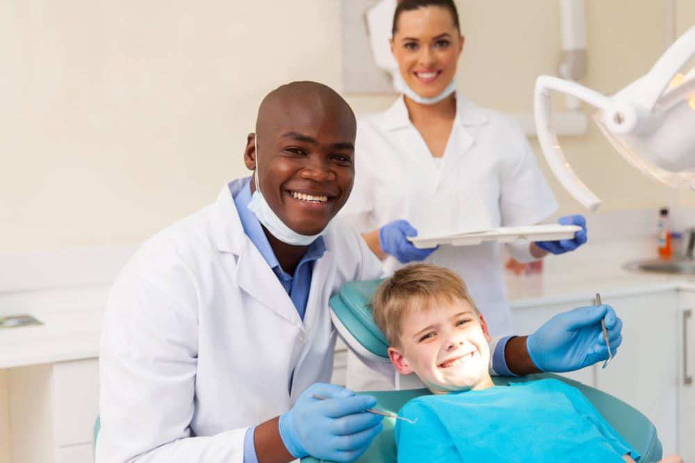 Dentist with Smiling Child in Dental Chair | Dentist in Gaithersburg