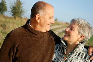 A couple smiles at each other | Gaithersburg MD Dentures