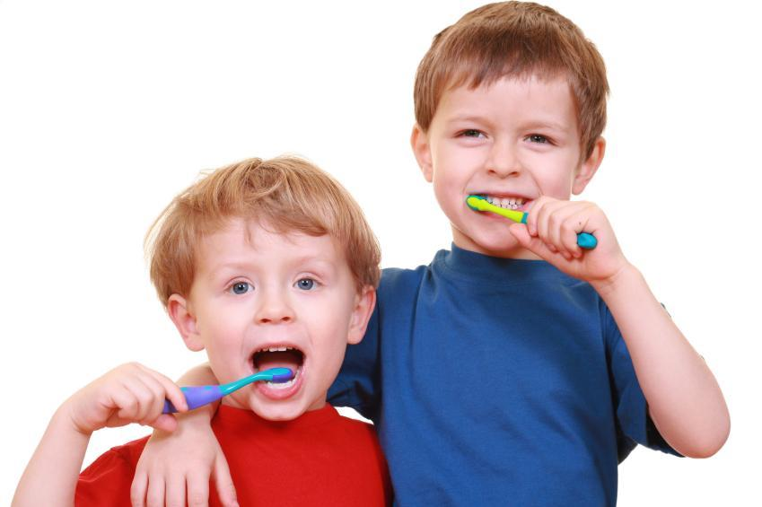Child's Dentistry in Gaithersburg | Two young boys brushing their teeth | Dentist Gaithersburg MD