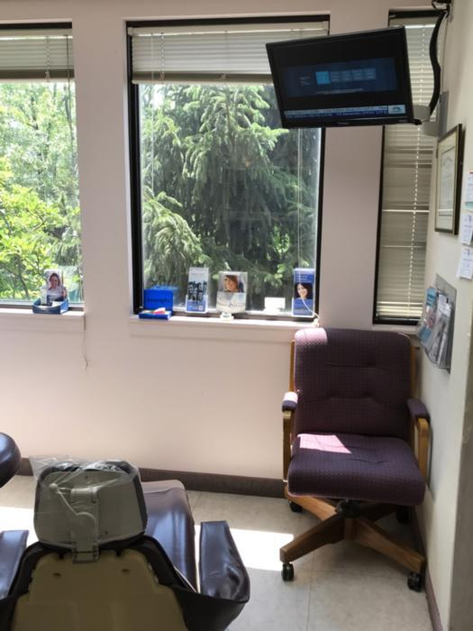 Dental room with tv above chair | Lakeforst Dental Associates