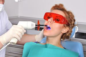 A woman receives laser dentistry | Tooth Colored Fillings Gaithersburg MD