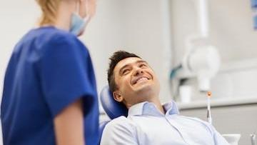 Man in Dental Chair with Hygienist | Dental Cleanings in Gaithersburg