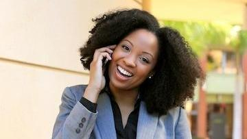 Woman talking on cell phone | Gaithersburg MD Dentist