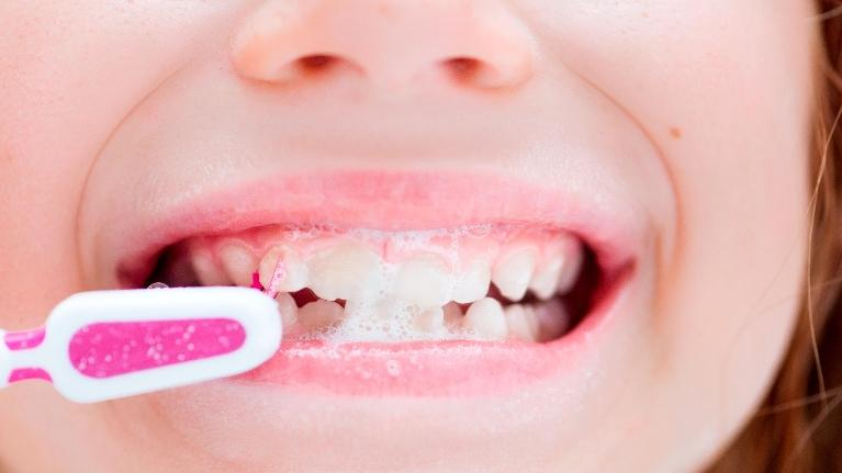 Up Close of Child Brushing Teeth | Top Dentist in Gaithersburg MD